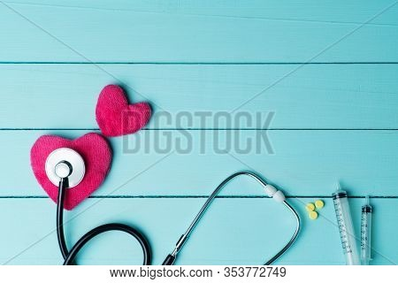 World Heart Health Day Concept And Healthcare Medical Insurance With Red Heart And Stethoscope On Bl