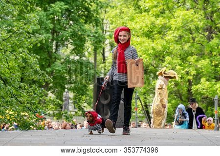 Russia, St. Petersburg, May 25, 2019: Portrait Dog Of The Dachshund Breed Dressed In Costume Artist