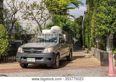 Patong, Phuket Thailand, January 5, 2020: Mazda Bt-50 Pickup Loaded With Palm Trees. Gardening And G