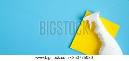 Cleaner Spray Bottle And Yellow Rag On Blue Background. Cleaning Service Banner Mockup. Housecleanin