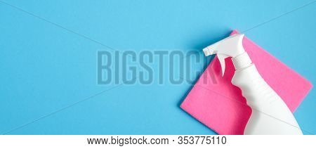 Cleaner Spray Bottle And Pink Rag On Blue Background. Cleaning Service Banner Mockup. Housecleaning