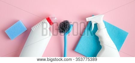 Cleaning Service Banner Mockup. Flat Lay House Cleaning Supplies On Pink Background. Top View Cleane