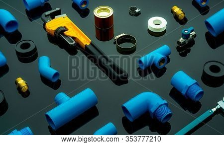 Plumbing Tools. Plumber Equipment. Blue Pvc Pipe Fittings, Glue Can, And Monkey Pipe Wrench. House P