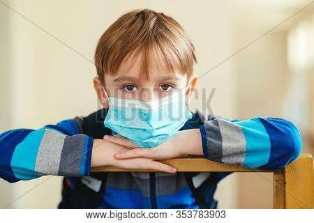Quarantine At School. Schoolkid With Protection Mask. Coronavirus Epidemic. Face Mask For Protection