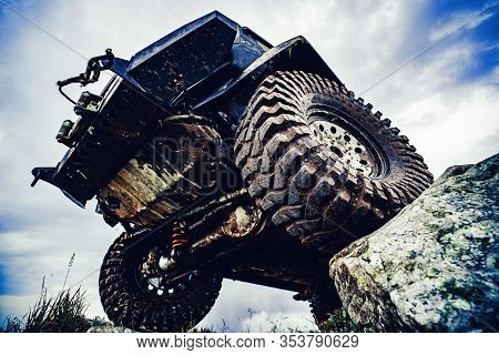 Big Tire. Off Road Car On Mountain Road. Car Tire. Tire For Offroad