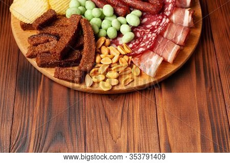 Set Of Snacks On A Wooden Board For Beer And Alcohol. Stock Photo Appetizer In A Bar.