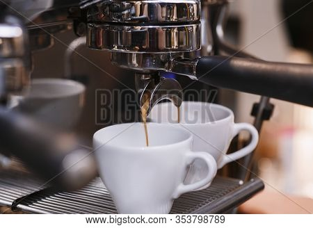 Closeup Of Working Coffee Machine With Cups, Barista Making Espresso In Coffeeshop. Selective Focus,