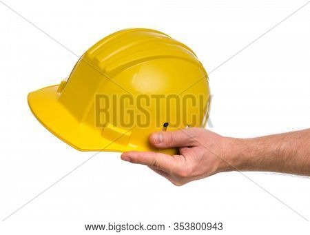 Male Hand with yellow safety helmet. Human Hand holding hard hat, Isolated on White Background.
