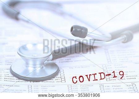 Concept of COVID-19 - Coronavirus disease - 2019-nCoV, WUHAN corona virus. Stethoscope close up photo.The inscription coronovirus COVID-19