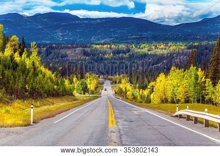 Highway 40 Bighorn. Beautiful asphalt highway goes into the distance. Northern Rockies - the main mountain range in the Cordillera. Canada. The concept of ecological, automobile and photo tourism