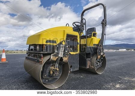Small Steamroller Repairing A Highway In Spain