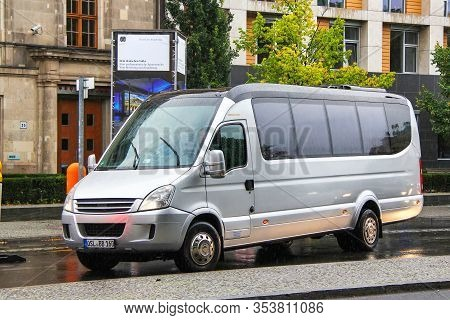 Berlin, Germany - September 11, 2013: Grey Toursitic Van Iveco Daily In The City Street.