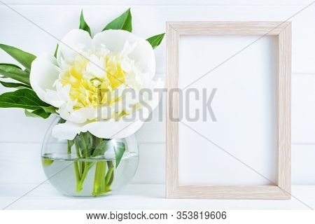 White Peony Flower In Vase On White Wooden Background With Mockup Or Copy Space.