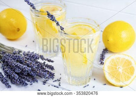 Refreshing Lavender Lemonade In Glasses On White Wooden Background.