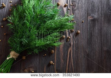 Bunch Of Fresh Dill And Spices On Dark Wooden Background. Flat-lay, Top View.