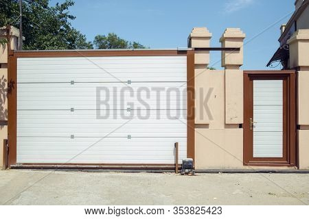 Shutter Door Or Roller Door And Concrete Floor Outside .white Automatic Shutters In A House . Gates