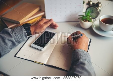 Calendar Reminder Event Concept.man Hand Planner Or Organizer Writing On Diary And 2020 Calendar Pag