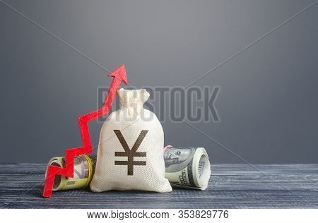 Yen Yuan Money Bag And Red Arrow Up. Economic Recovery And Growth, Optimistic Forecast Of Economic R
