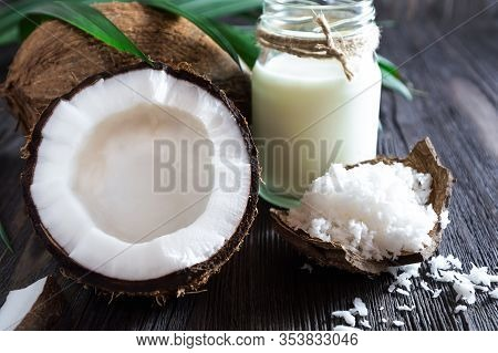 Coconuts, Coconut Milk And Shavings, And A Palm Branch.