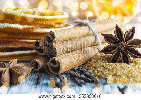 Christmas Spices - Cinnamon Sticks, Star Anise, Cloves And Slices Of Dried Orange On Christmas Light