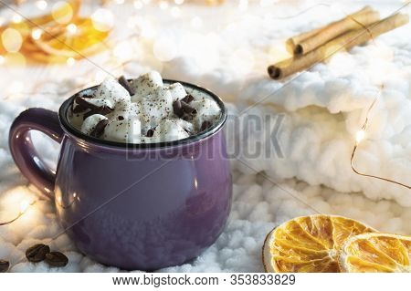 Hot Cocoa With Marshmallows, Slices Of Dried Orange And Cinnamon Sticks On Knitted Fabric. Christmas