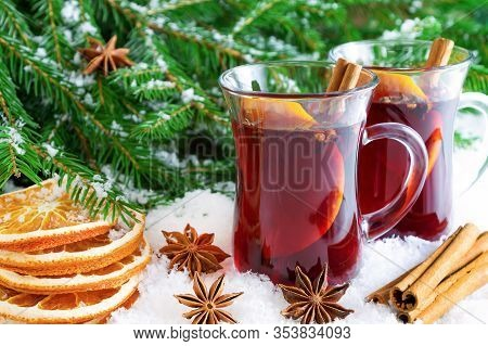 Christmas Mulled Red Wine With Spices And Oranges On The Snow. Traditional Hot Drink At Christmas.