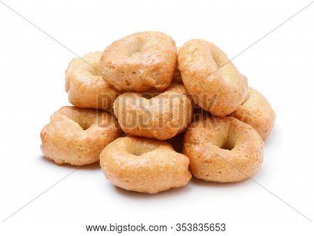 A Pile Of Taralli Pretzels On White Background