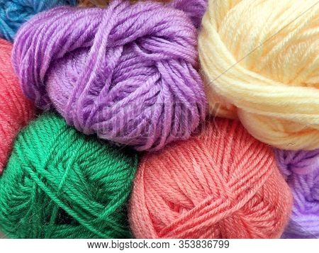 Many Multi-colored Skeins Close-up. Multicolored Skeins For Knitting