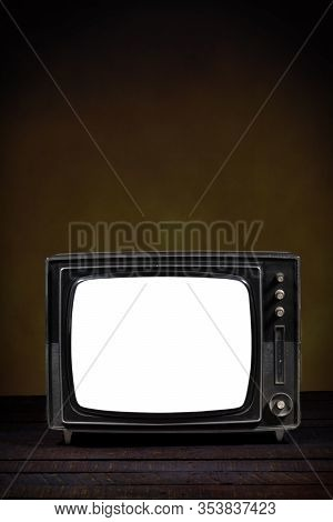 Old Portable Television, With Blank Screen. Wooden Table And Brown Background. Vertical Version. Con