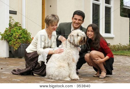 poster of happy family with a dog in front of the home