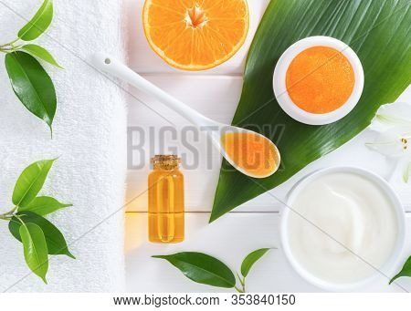 Natural Homemade Cosmetics: Scrub, Cream And Lotion With Orange Fruit On White Background. Organic B