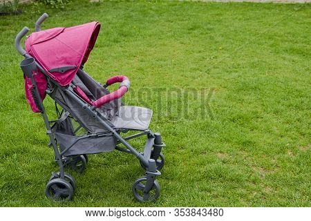 Baby Stroller On The Grass, Gray And Pink Color Stroller New On Grass For Baby
