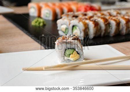Sushi Unagi Eel Roll On A Plate In A Restaurant