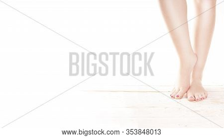 Beauty Female Feet. Healthy Feet With Painted Toenails On Wood Floor On A White Background, Wide, Fr