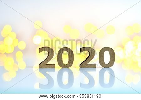Wooden Numbers 2020 On A Pink Background With Bokeh New Year's Lights.the Concept Of The New Year, N