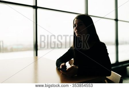 Real Young pretty woman with long hair on the phone,shadow