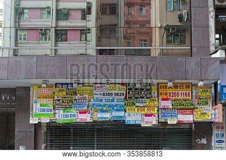 Kowloon, Hong Kong - May 01, 2017: Store Front Covered With Telephones Posters In Kowloon, Hong Kong