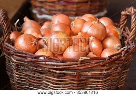 Red Onions In A Wooden Basket. The Spring Avitaminosis.selective Focus. Close Up