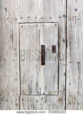 Old Wooden Rustic Wall With Small Door.