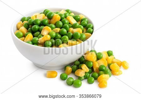 Fresh Green Garden Peas And Sweetcorn Mix In A White Ceramic Bowl Isolated On White. Spilled Peas An