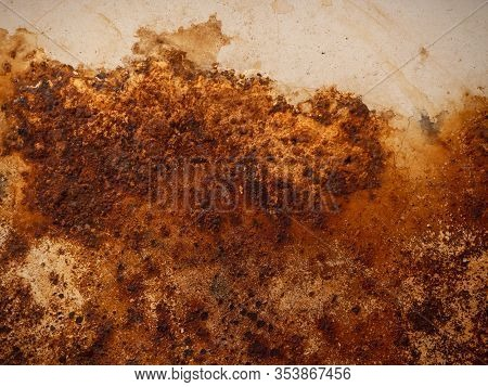 Brown And Yellow Rust On White Enamel. Rusted Brown And White Abstract Texture. Corroded White Metal