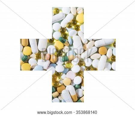 Medicines And Pills On A White Plate. A Pile Of Multi-colored Tablets Disguised As Food On A Plate W