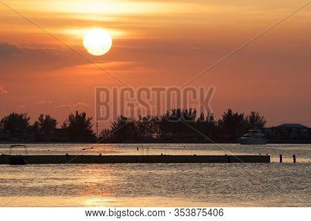 The Sun Slowly Going Down Lightning Up Nassau Harbour (nassau, Bahamas).