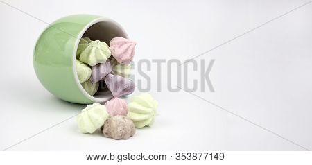 Marshmallow Multicolored. Meringue Marshmallows In A Green Cup On A Light Background. Colorful Merin
