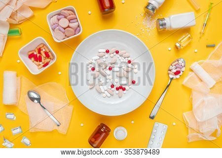 Drug Abuse And Medical Overuse Concept, Top View Flat Lay Plate With Medicine Tablets And Pills