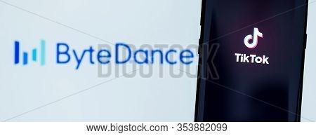 Kiev, Ukraine - March 3, 2020: Tiktok App Displayed On Smartphone Screen With Bytedance Logo On Back