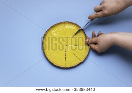 Slicing Lemon Pie Tart. Lemon Pie Flat Lay On A Blue Background. Single Slice Of Lemon Pie. Sliced F