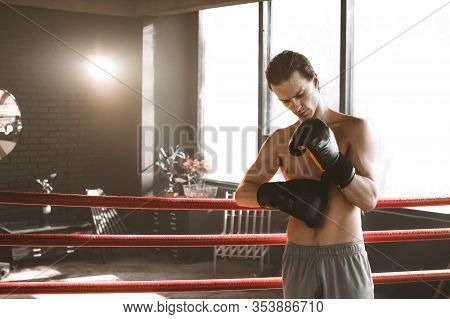 Boxing And Sports Concept. Athlete Boxer With Leather Box Equipment In Boxing Ring. Boxer Makes Hits