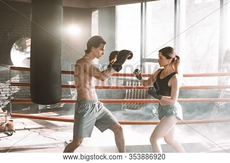 Boxing Workout. Couple Man And Woman Boxing Together In The Boxing Ring At The Gym. Sport Box Exerci