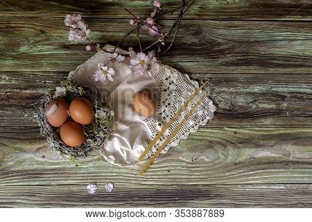 The Easter Composition.  A Bouquet With Almond Branches, Nest, Eggs And Candles On Wooden Table Clos